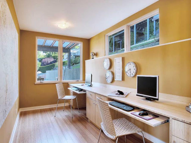 an inspiring long wooden two person desk home office completed with two unique computer chairs also some wall mounted clocks