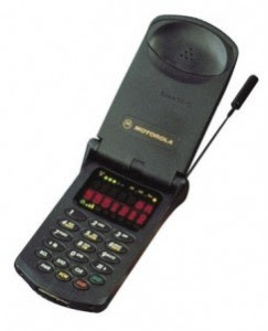 first flip phone, motorola, black plastic, antenna