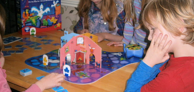 children playing spooky steps board game