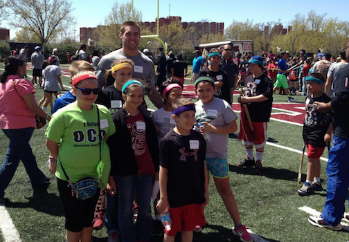 Cherokee youth take a photo with University of Oklahoma quarterback Trevor Knight at the Sooners for N7 event Wednesday.