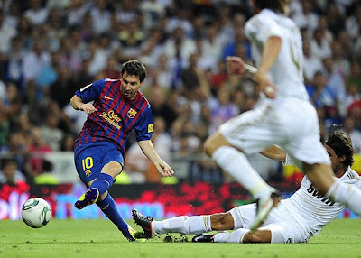 Messi scoring a goal against Real Madrid