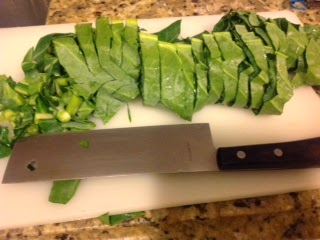 large chopping knife and cut collard greens