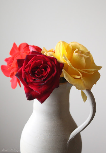 flowers, flower, photography, roses, rose, bloom, sarah, myers, yellow, red, geranium, bouquet, bunch, ceramic, amy, myers, pitcher, tea rose, bright, brilliant, colourful, interior, decor, decoration, photograph, beauty, brilliance, dim, day