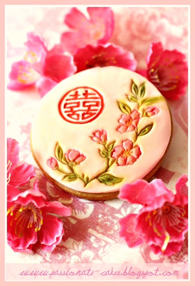 Four different Oriental design wedding cookies to be given to her