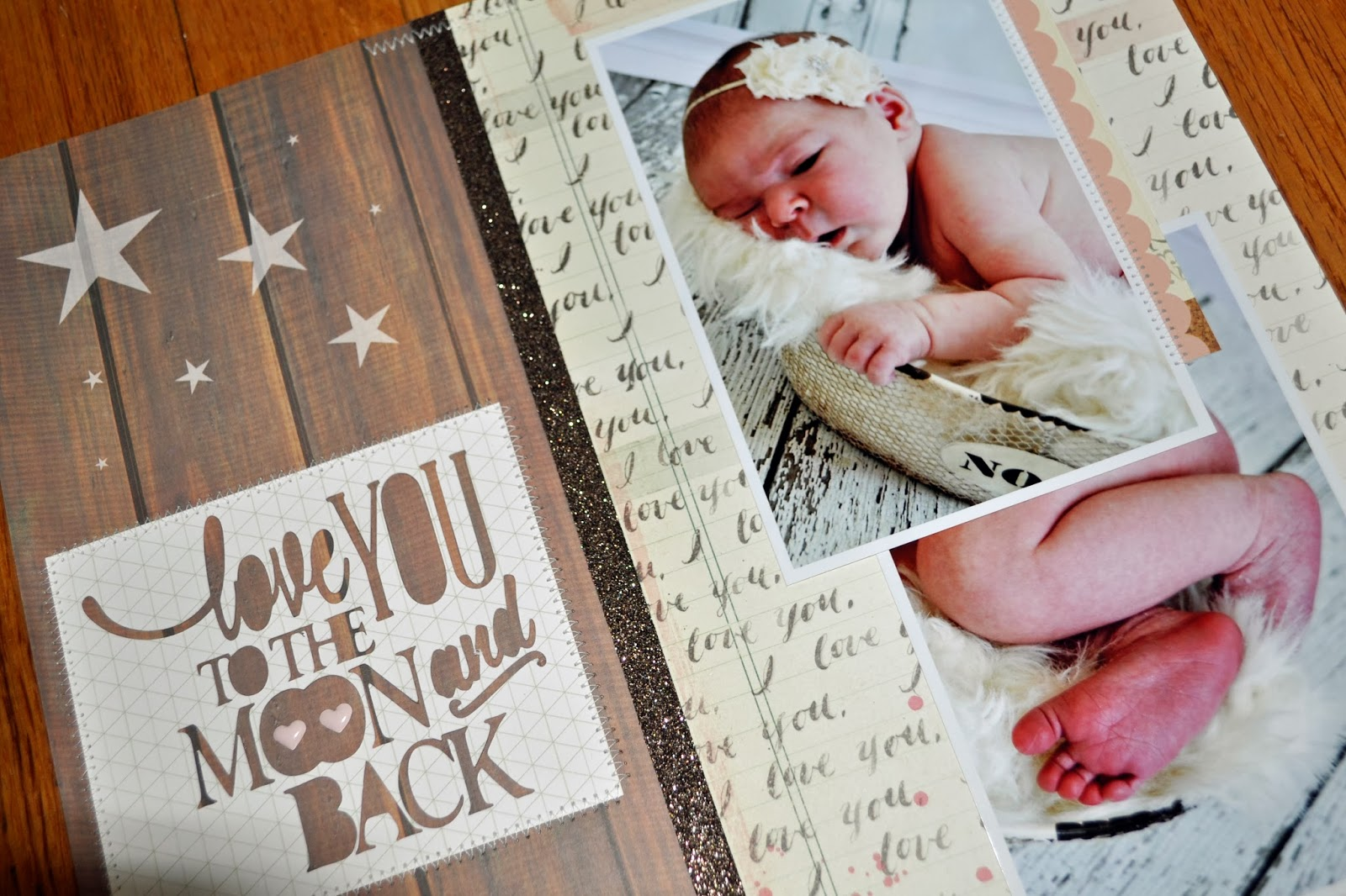 love you to the moon and back scrapbook page 12 x12 inspiration layout silouhette cut file title phrase baby photos brown wood panel i love you cream ivory pink glitter ribbon zig zag machine stitching stars