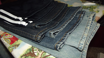 Four pairs of hemmed pants