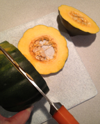 Cut the end off the squash, then cut the rings from the middle