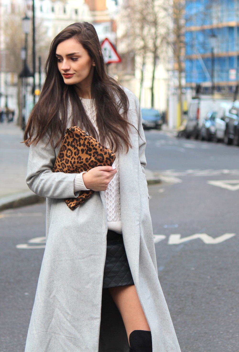 Peexo fashion blog spring outfit quilted leather skirt cable knit jumper maxi coat and leopard print clutch
