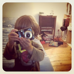 with her very firts camera (a cheap one)
