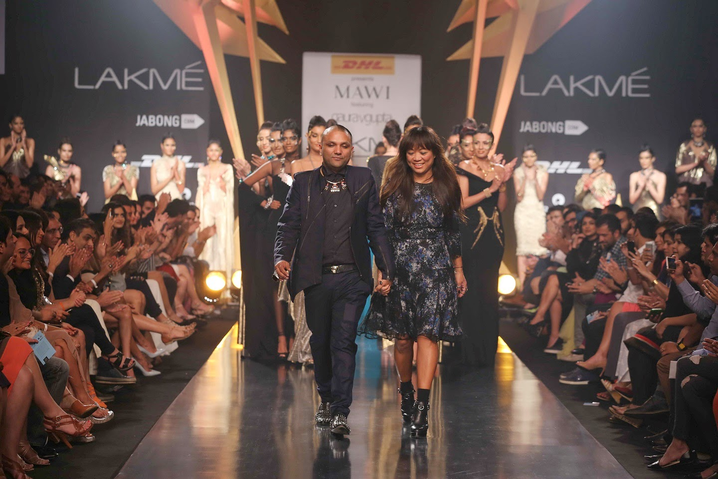 "Showcasing one of the most dazzling collections Gaurav Gupta's debut appearance at Lakmé Fashion Week Summer/Resort 2014 was a fabulous futuristic show called ""Memphire"". There was glitz, glamour and large doses of grandeur as pairs of models strutted down the catwalk in Gaurav's creations adorned with Mawi Keivom's heart stopping jewellery. The glitter of metallic jersey, gold and black shimmer of sequins was highlighted by colours like gold, copper, black, anthracite, flame orange and teal. Inspired by the regal creations of ancient Egypt, the silhouettes were slender and lean and revealed a distinct contrast between diamond sharpness and Egyptian futuristic drapes. A master of drapes and silhouettes that completely push the construction envelope; Gaurav displayed his expertise with Carbon Lattice, Isis, Serpent Wave and Diagonal Murmur."