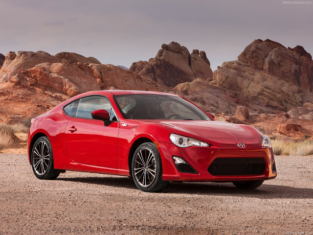 Front three-quarters view of Red 2013 Scion FR-S in desert setting