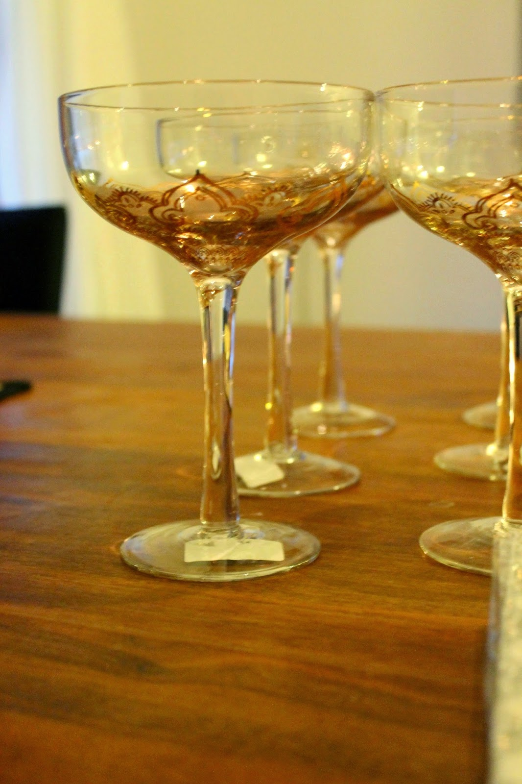 Indiska large champagne glasses with golden detailed bottom