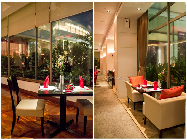Tables by the big windows at Rosso Shangrila Jakarta for amazing view