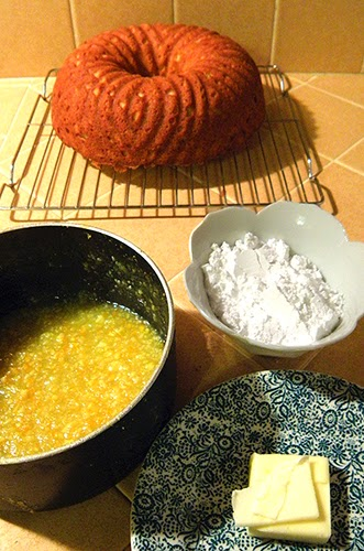 Cake in Background, Cooked Glaze in Saucepan, Butter and Powdered sugar foreground