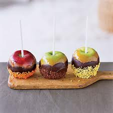 Chocolate covered apples with crushed nuts and chocolate sprinkles yumm!!!