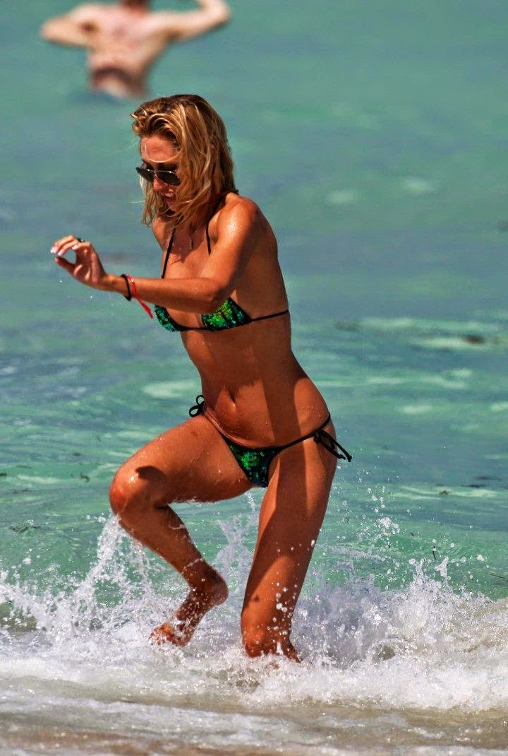 Lauren Stoner wears a green bikini at Miami on Sunday, April 20, 2014