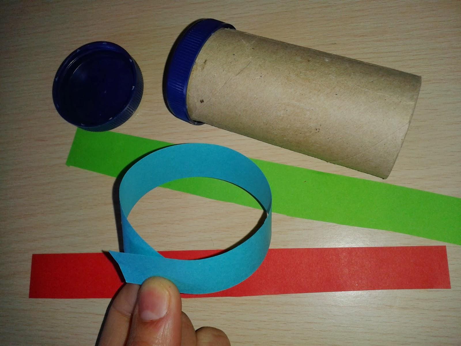 una vez hecho sto se meten las tiras de cartulina yo las plastifiqu con papel de forrar para que as me dure ms en el rollo de cartn y despus se