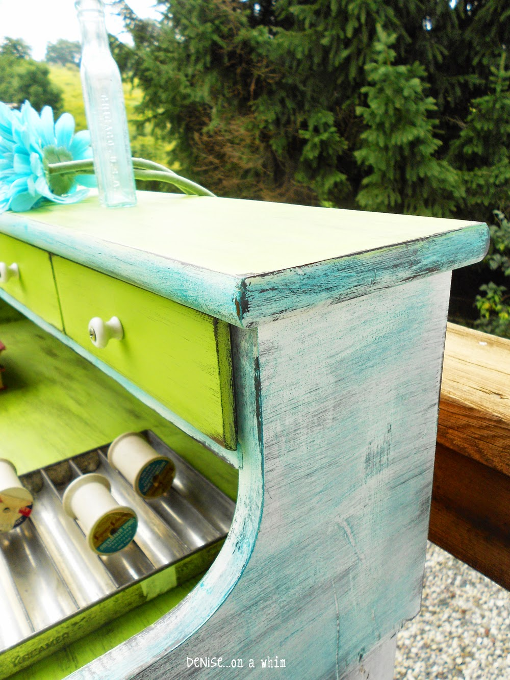 Dry-brushed teal blue over white on a dry sink makeover from Denise On a Whim