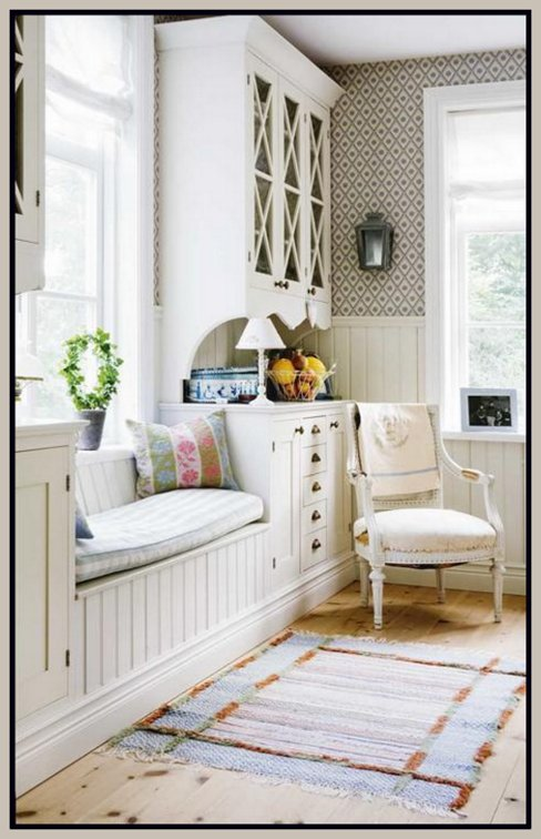 you can create a custom builtin look by connecting two hutches on two sides of the room and then connecting them with a custom window seat