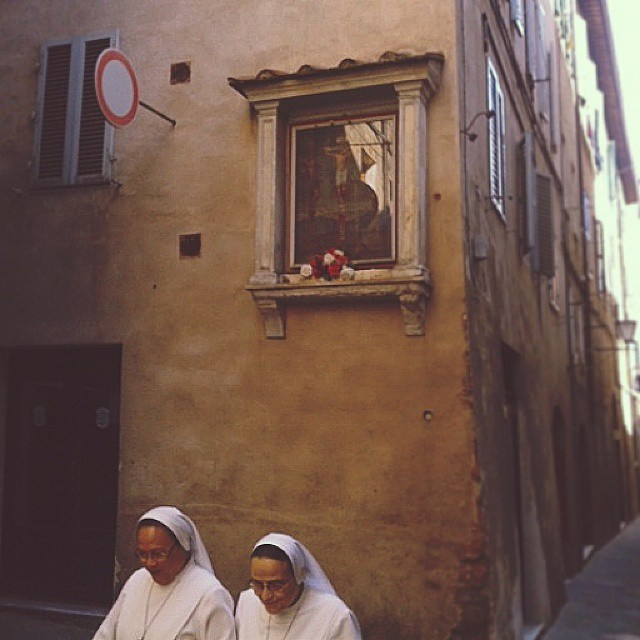 Two nuns on a morning walk in Siena's historic town center