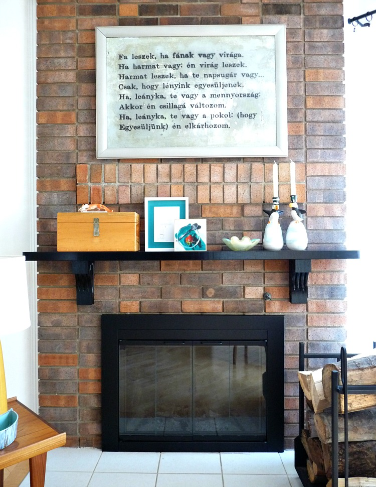Black fireplace mantle with aqua accessories