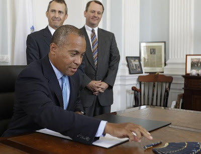 Deval patrick shaved his head, pigtail tit