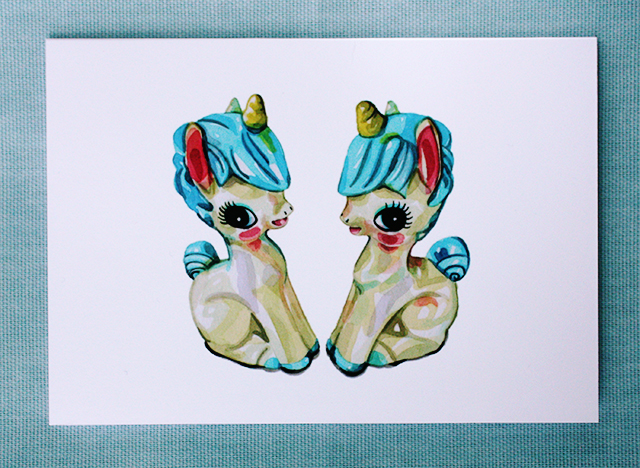 unicorn card by laura manfre on light blue background