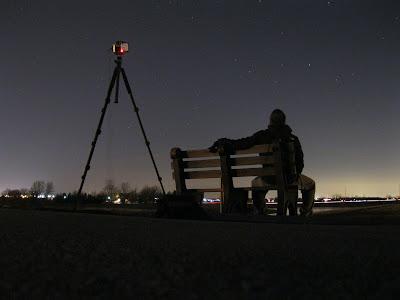 night photo sitting on a bench