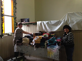 imageOmemee Baptist Church: Gail and Joy with Table full of Knit Gifts for Omemee Parade