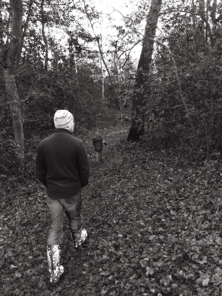 black and white image of man and toddler in woods