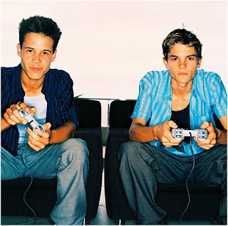 image of young men playing video game