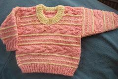 Rózsaszín babapulcsi