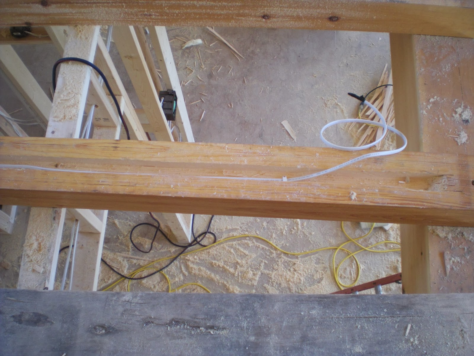 wire cut into timber frame floor joist beam