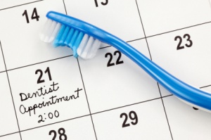 dental checkup calendar with toothbrush
