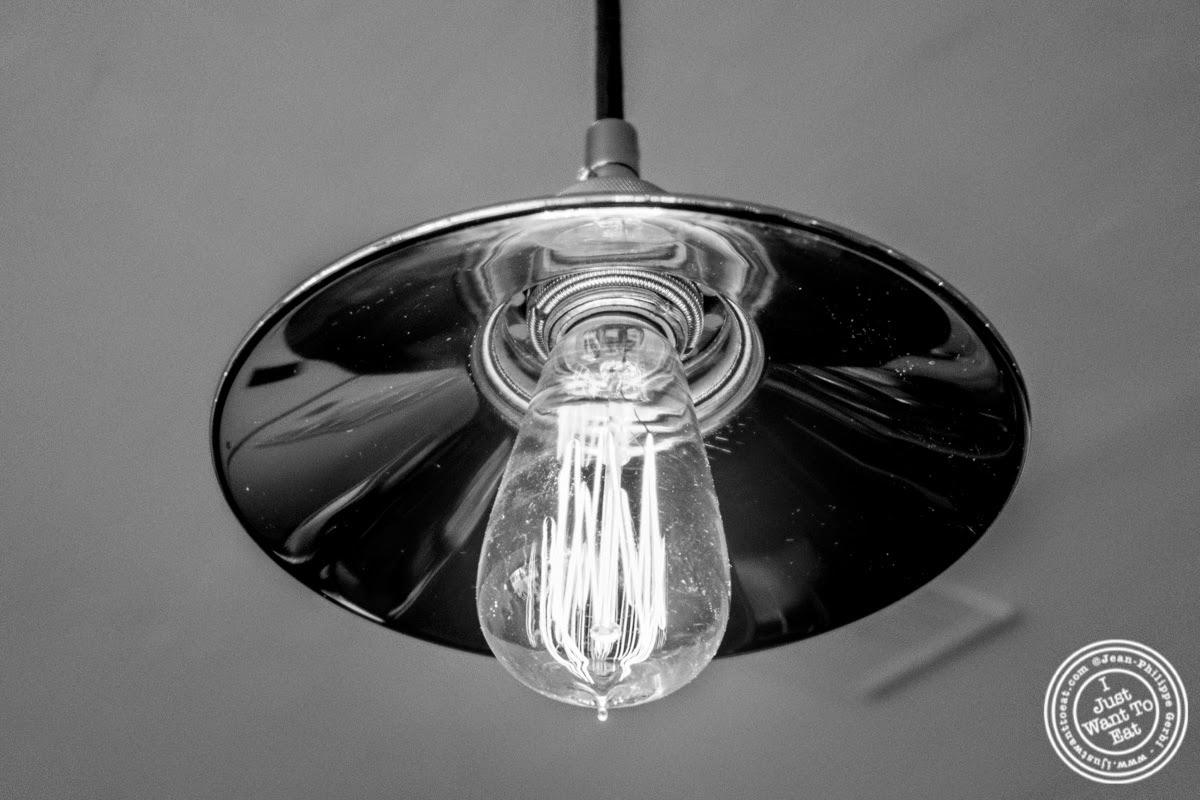 image of vintage bulb at Frere de Lys, French restaurant on the Upper East Side, NY