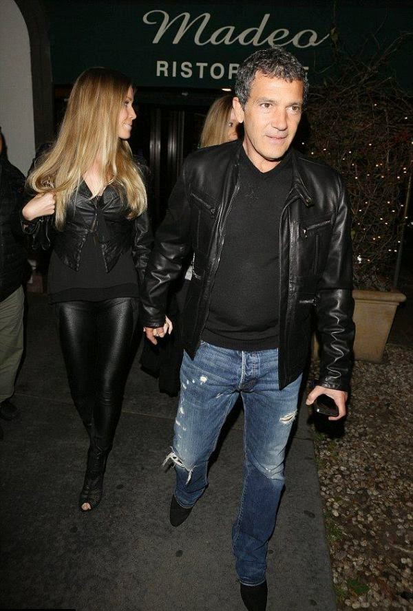Is it a Christmas elf? No, it's Antonio Banderas, 54, dining with new girlfriend, Nicole Kimple, 34, at Madeo Restaurant in West Hollywood on Thursday, February 26, 2015.