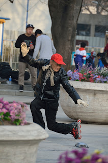 Elderly skater on the plaza and Wangfujing Catholic Church