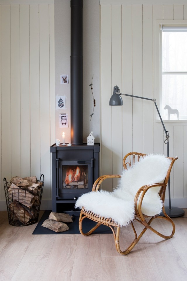 REad by a log fire in a Scandi Log Cabin