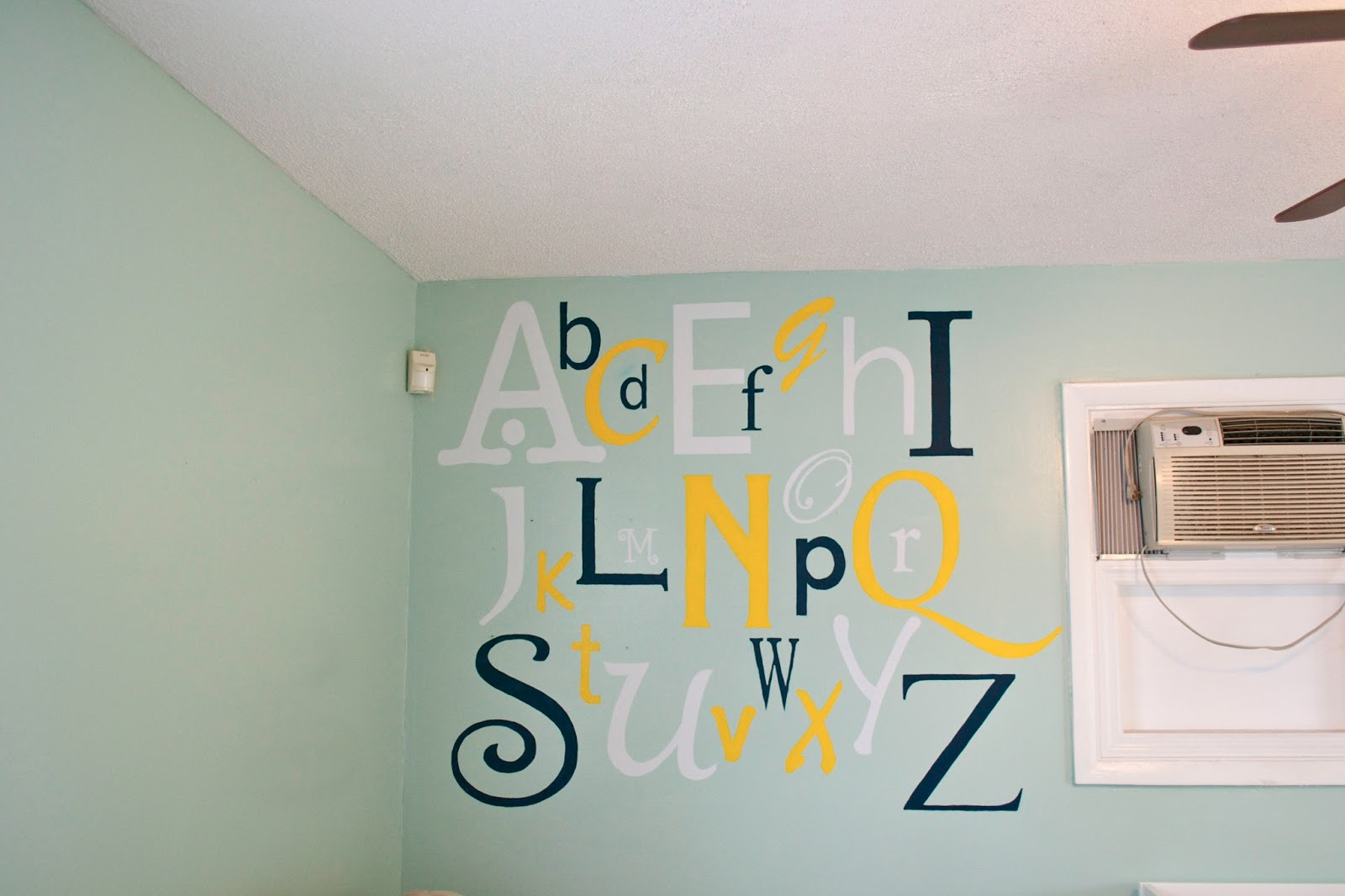 seesaws and sawhorses getting our nerd on a couple of weeks ago i showed you our alphabet wall mural for the baby s room it is now finished after 2 3 coats of paint were applied depending on the