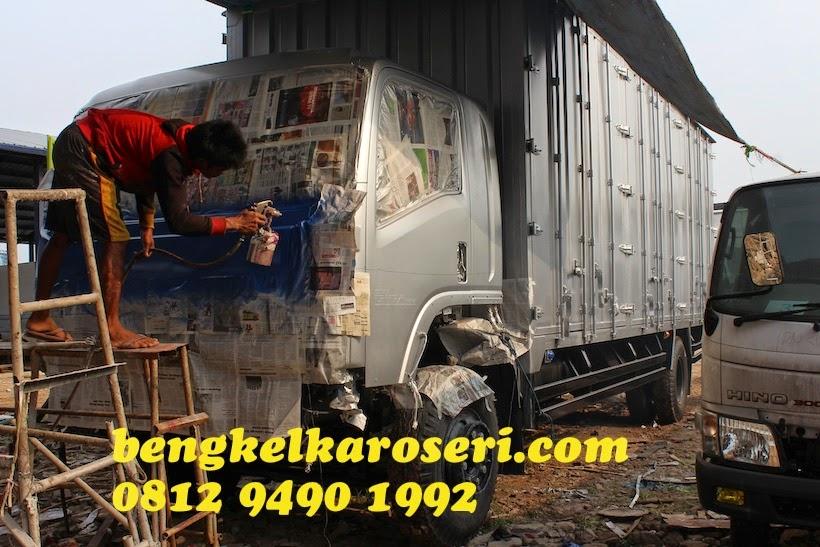 Cat ulang kabin dan pemasangan karoseri unit baru