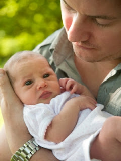 father hold newborn baby