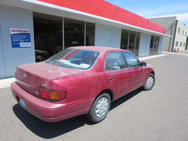 1995 Camry with peeling paint and collision damage before repairs at Almost Everything Auto Body