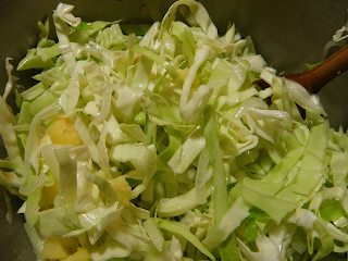 Cabbage, Apples, and Cider Being Stirred in Pot