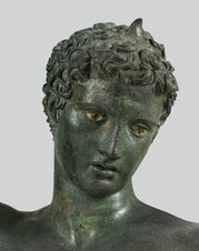 ancient Greek male statue from the National Archeological museum of Greece