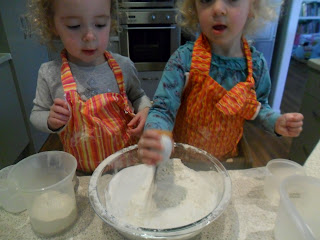 Stirring sugar and baking powder with flour for rainbow cake.