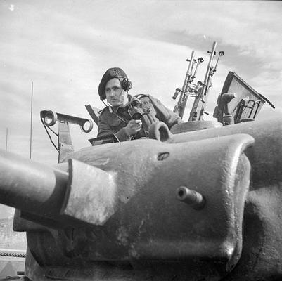 WW2 commander of 8th Princess Louise-s_New Brunswick_Hussars-Sherman tank- giving orders to his gunner during  firing exercise- Italy- March 2nd 1944