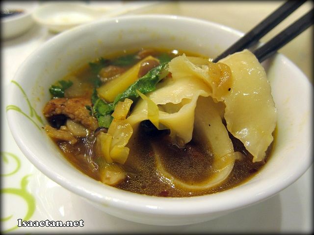 Knife Shaved Noodles was served in a Pickled Vegetable Soup