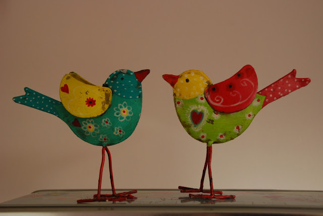 image of two tin birds