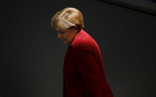 Αντιμέτωπη με τους βουλευτές της για το ελληνικό χρέος η Μέρκελ