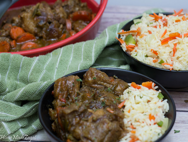 Stewed Oxtails: A popular Caribbean dish of slow cooked oxtail in a stew of sweet and savory spices. #HomeMadeZagat
